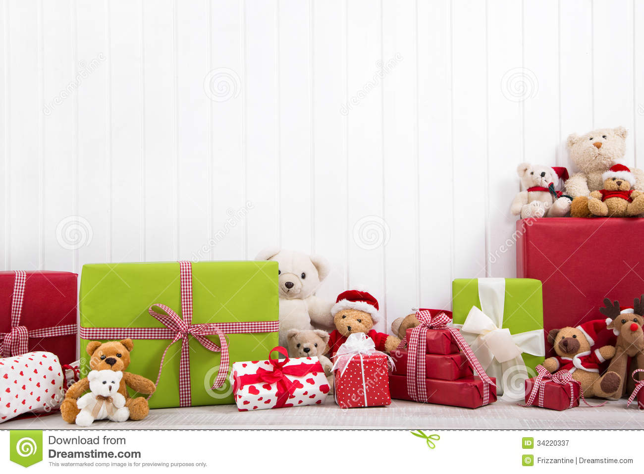 Red And Green Christmas Presents With Teddy Bears On White Backg ...