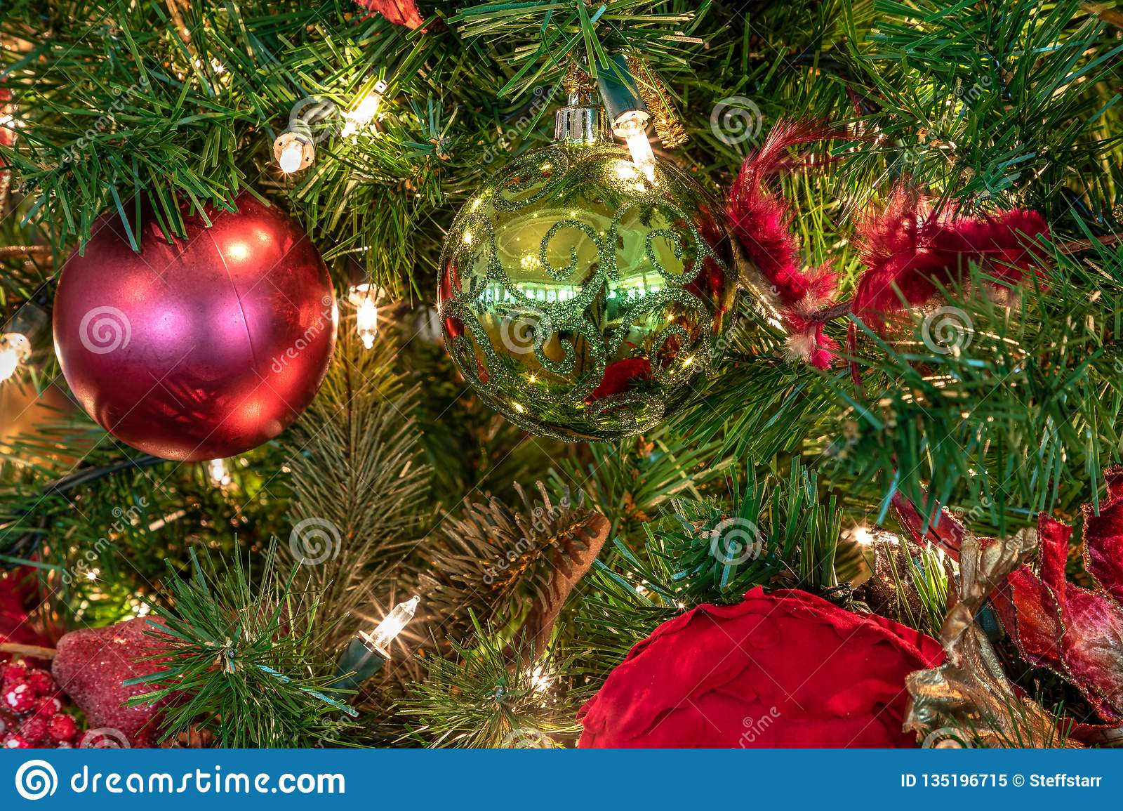 Red And Green Ornaments On A Christmas Tree With White Lights Stock Image - Image of glowing ...