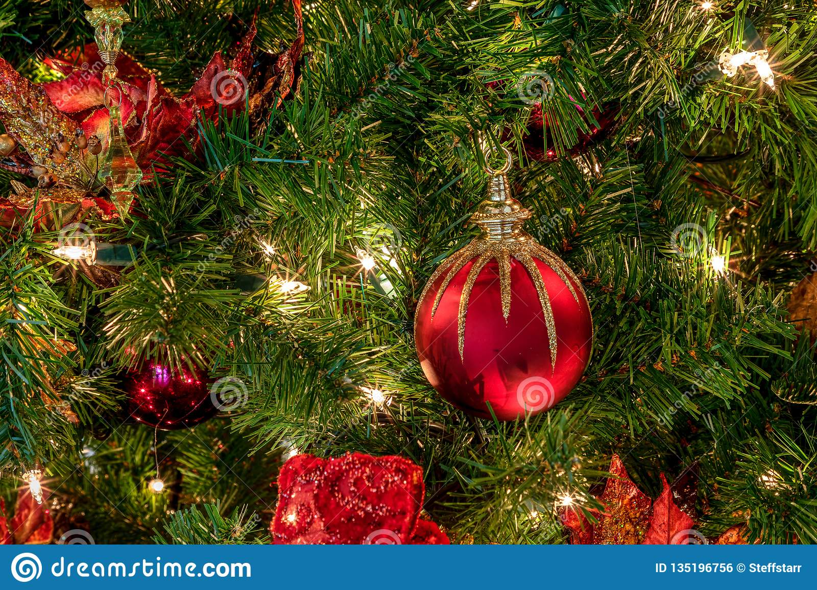 Red And Green Ornaments On A Christmas Tree With White Lights Stock Photo - Image of green ...