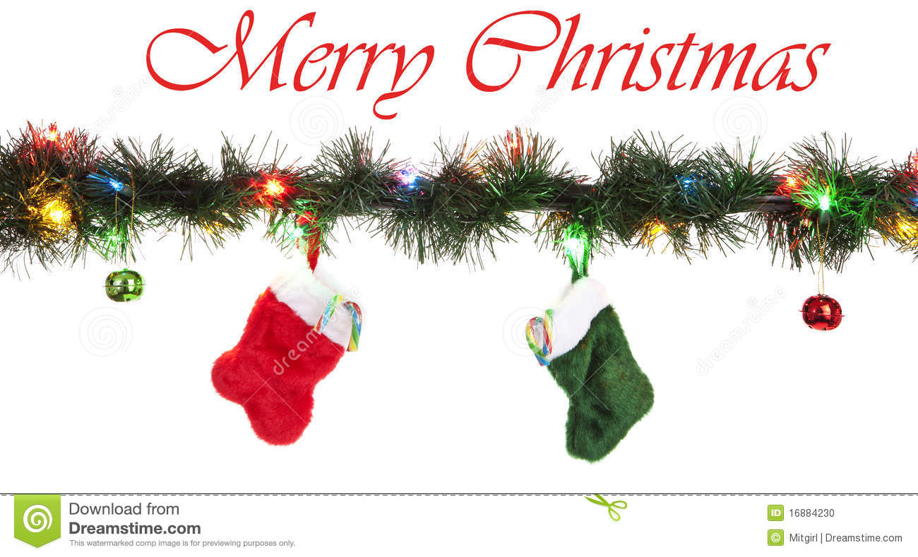 red and green stockings with candy cane and ornaments hanging from led christmas lights isolated white