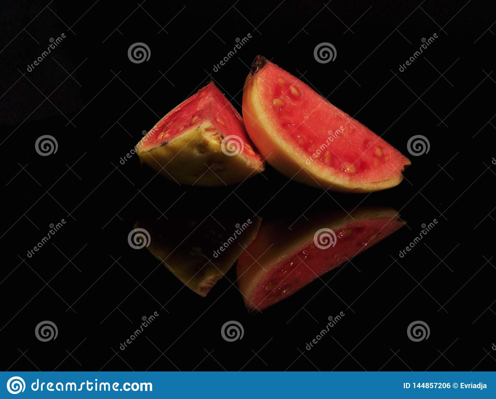 RED GUAVA ISOLATED ON BLACK BACKGROUND
