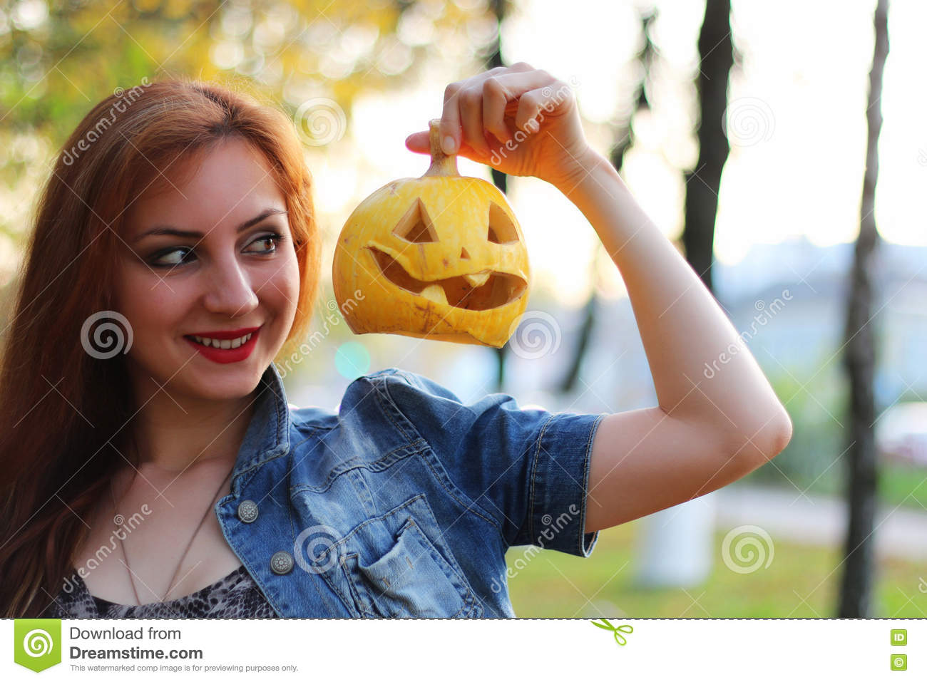 red-haired girl halloween pumpkin stock photo - image of halloween