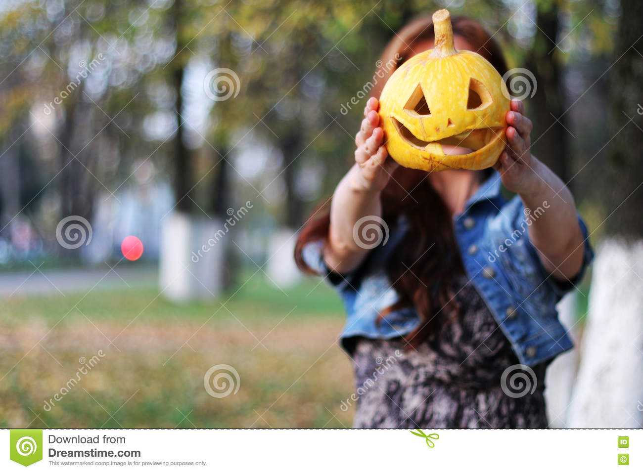 red-haired girl halloween pumpkin stock image - image of garden