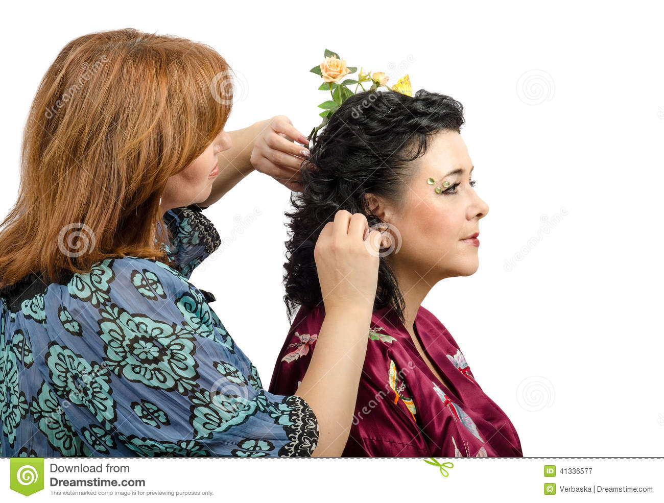 Red Haired Hairdresser Giving A New Hairstyle To Mature Woman Stock