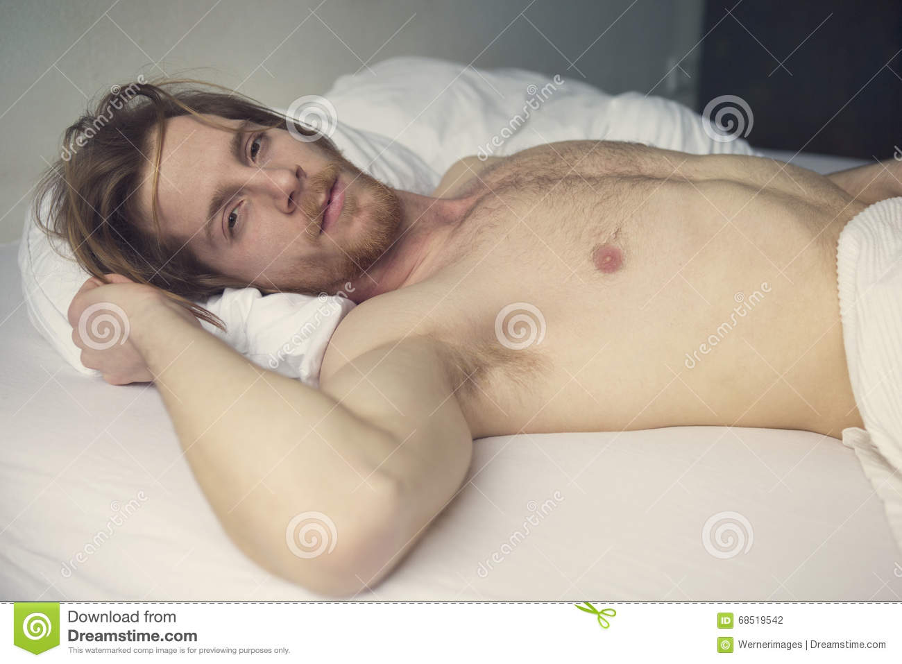 Naked man bed