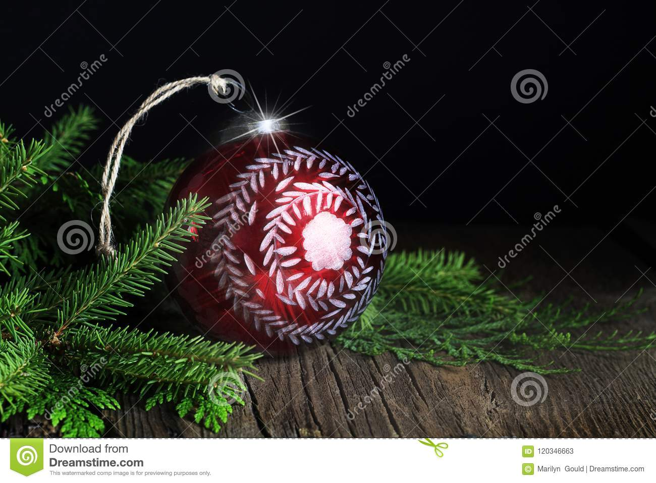 Red Handpainted Christmas Ornament With Evergreen Stock Image