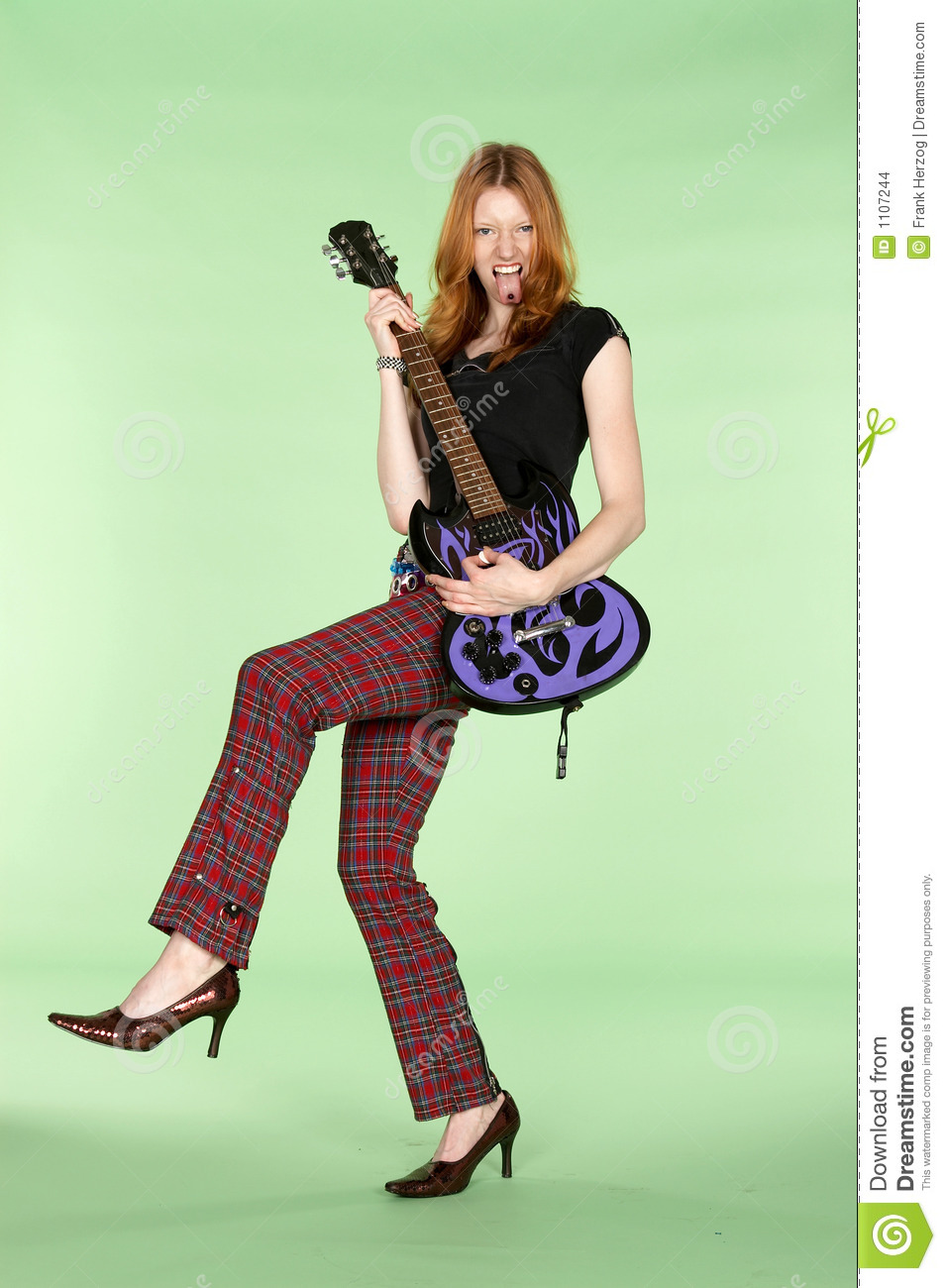 Red Head Rock And Roll Guitar Player With Leg Up Stock ...