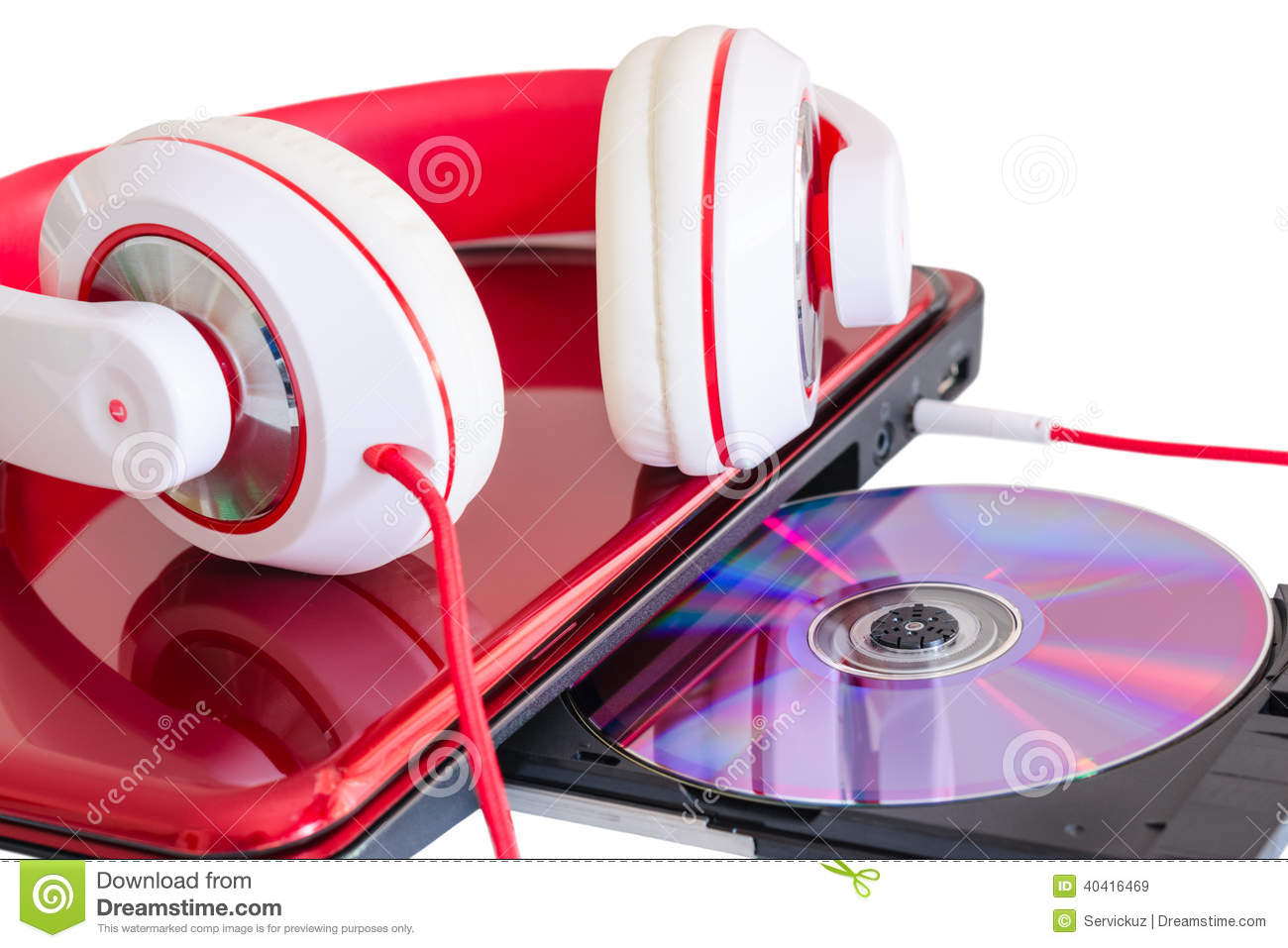 Red headphones and laptop with compact disk