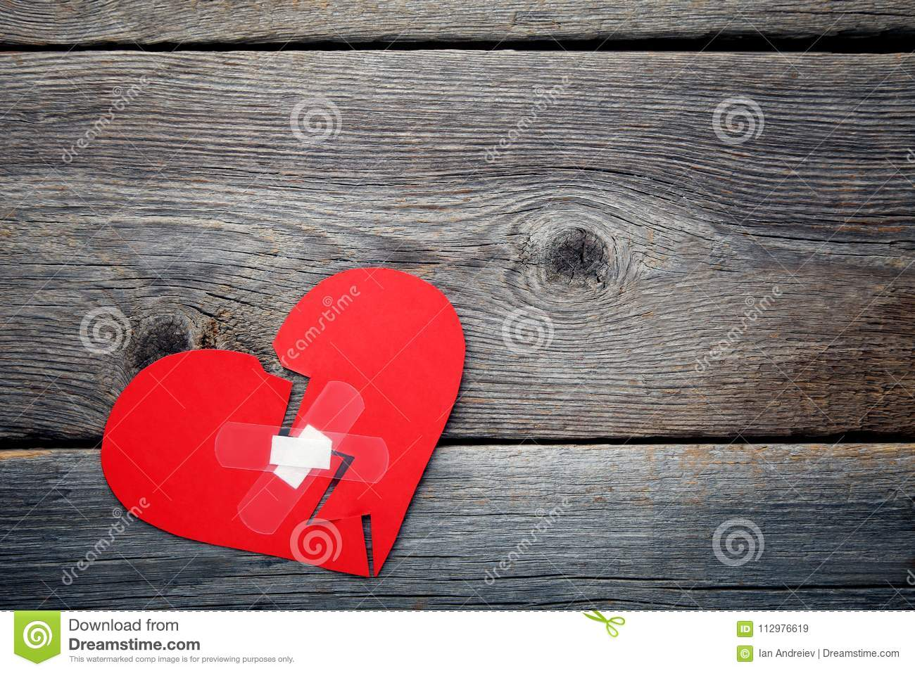 Red heart with adhesive bandage