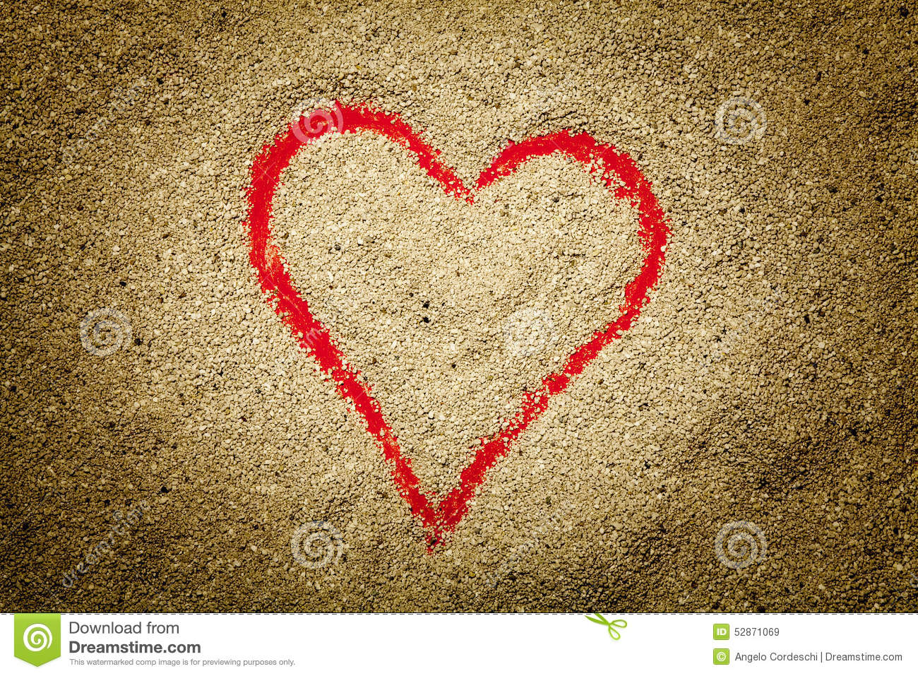 Red heart drawn in the sand