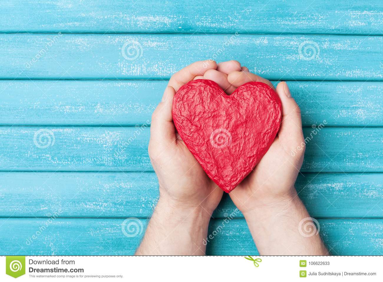 Red heart in hands top view. Healthy, love, donation organ, donor, hope and cardiology concept. Valentines day card.
