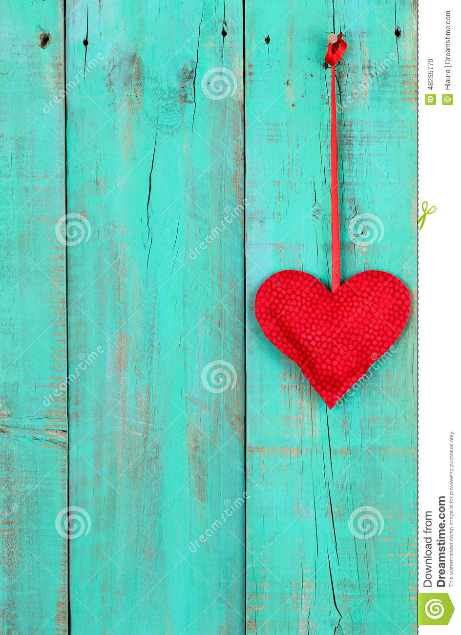 Red Heart Hanging By Ribbon On Antique Teal Blue Wooden