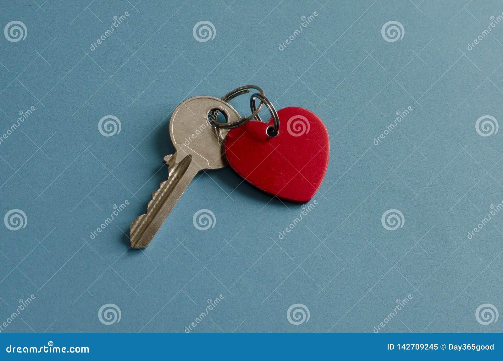 Red heart key chain. Key. Blue background