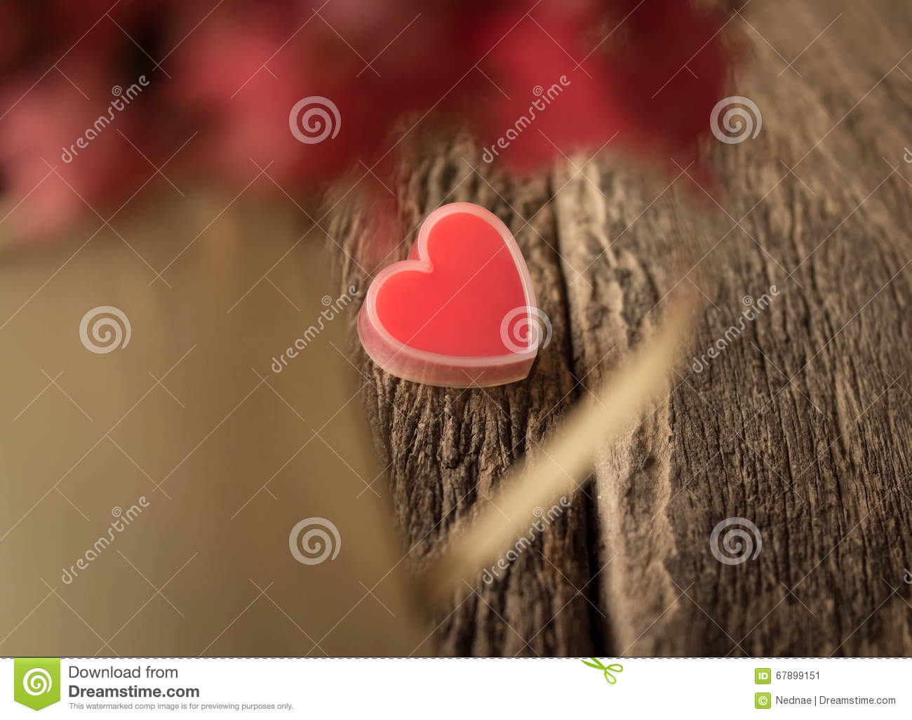 Red heart on old wood