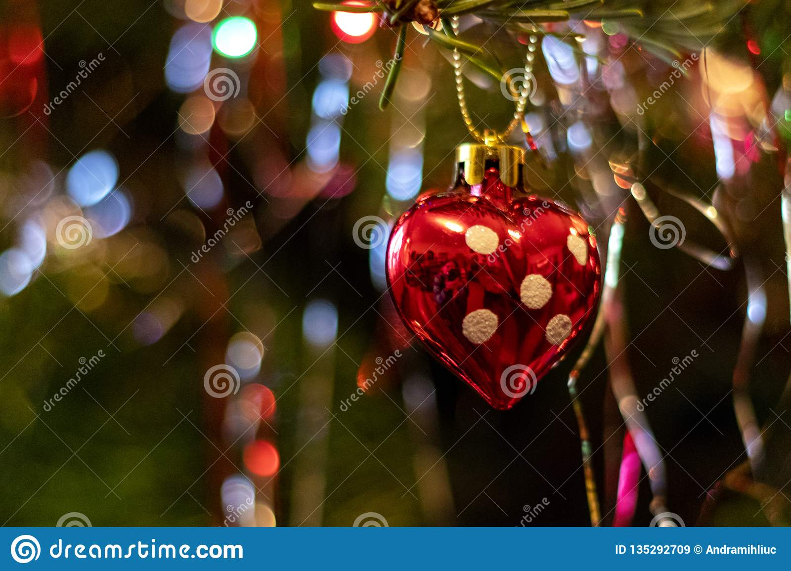 Red Heart Ornament In The Christmas Tree Stock Image