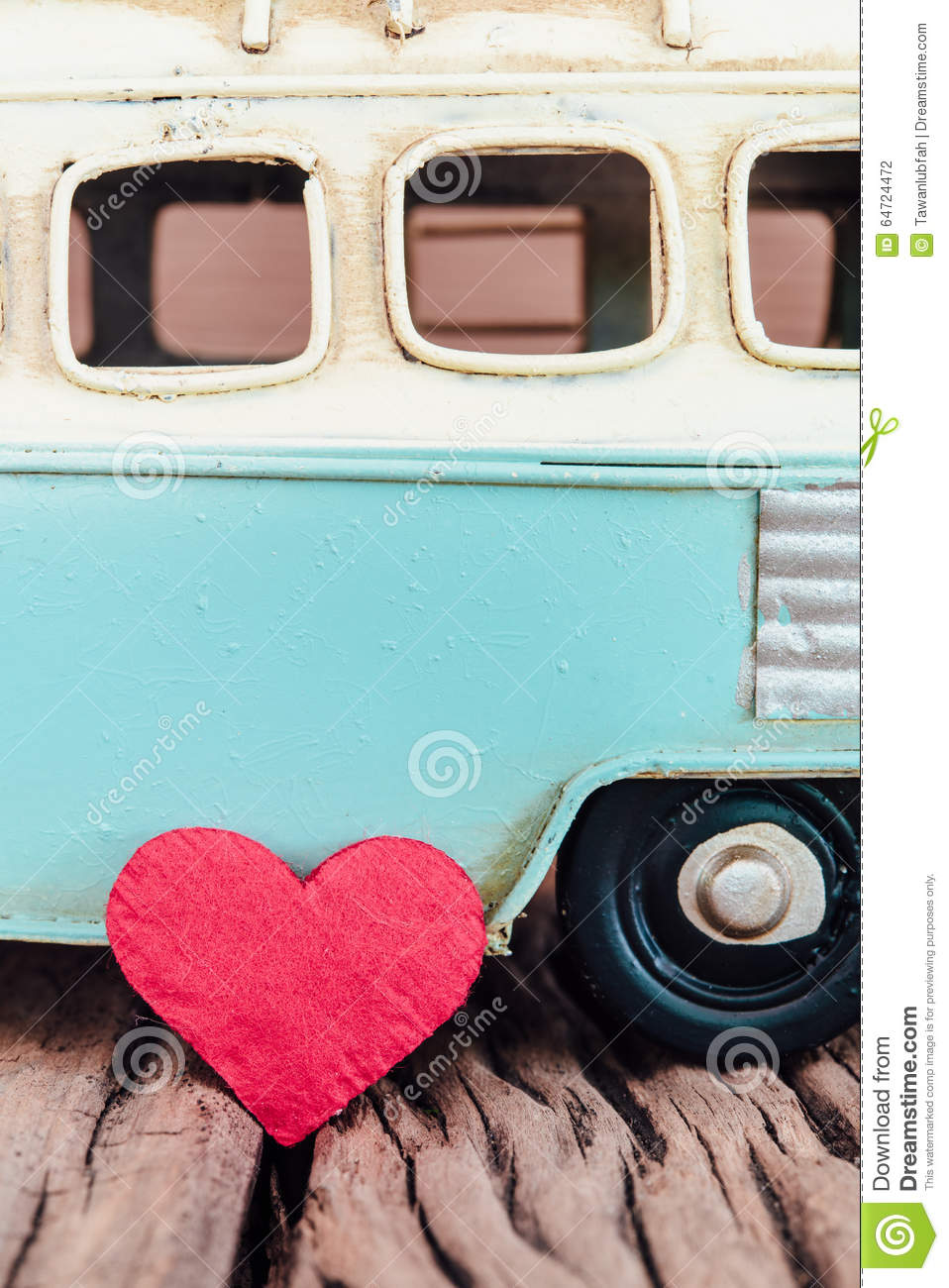 Red heart with part of vintage blue van background on old wooden