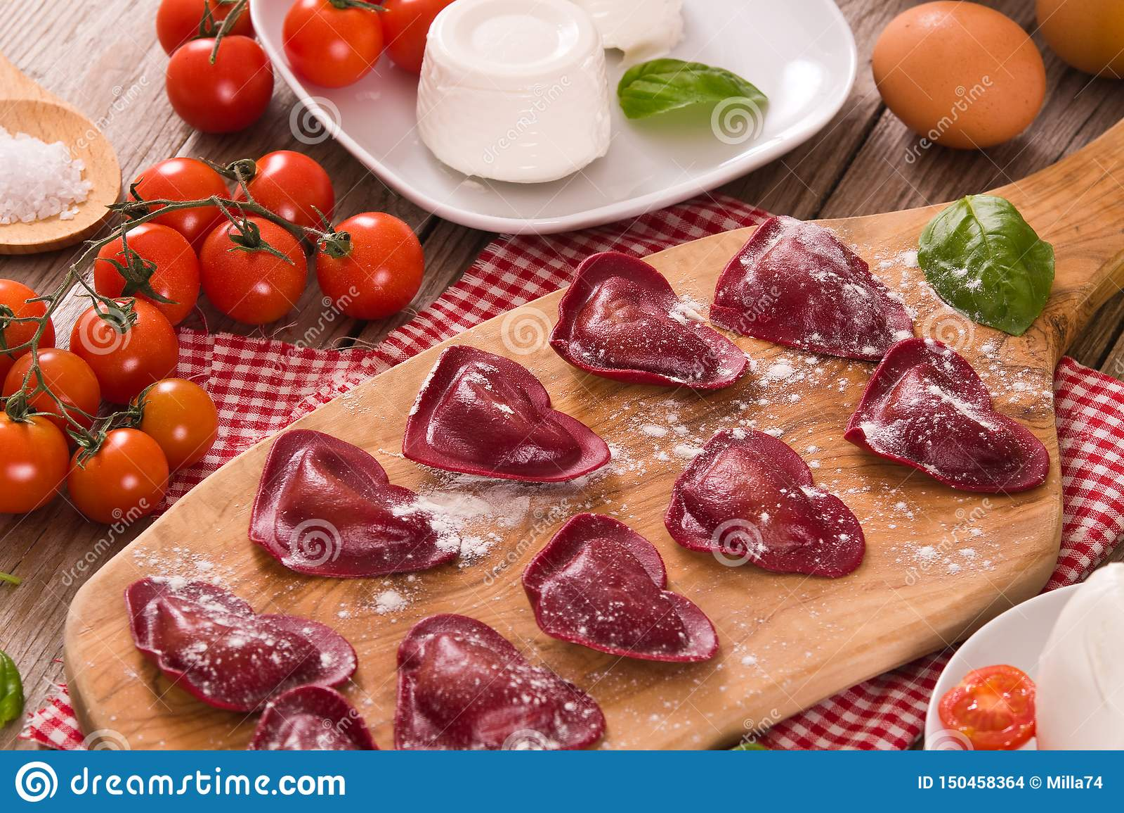 Red heart r.avioli with tomato, mozzarella and basil.