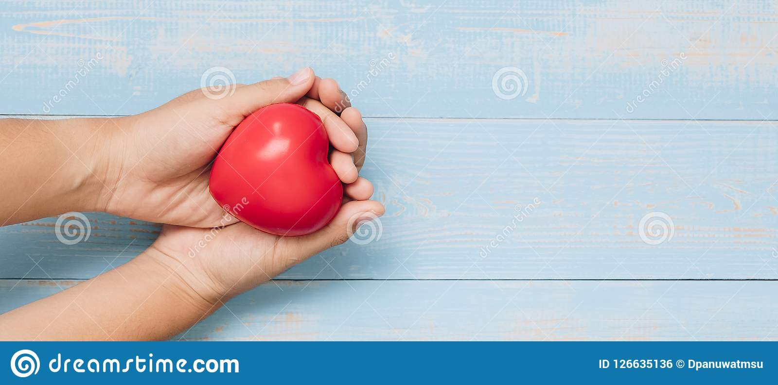 red heart shape on pastel color wooden background. healthcare, organ donation, and insurance or Love and Valentine Day Concept