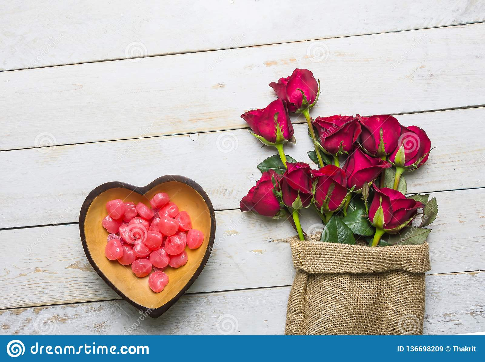 Red heart shaped candy bowl and rose
