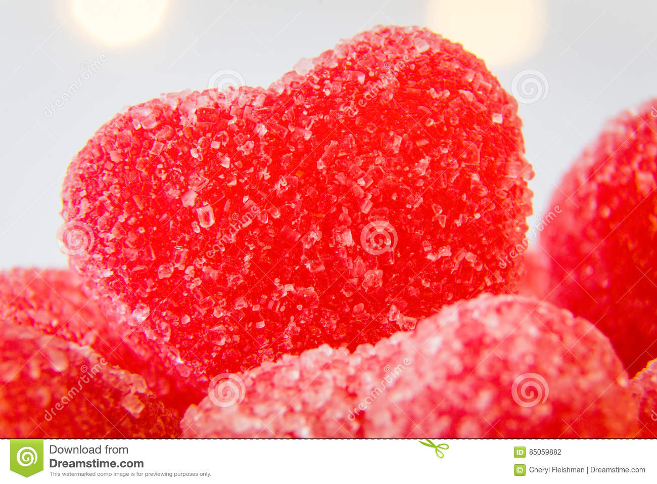 Red heart shaped sugar candy in a bowl