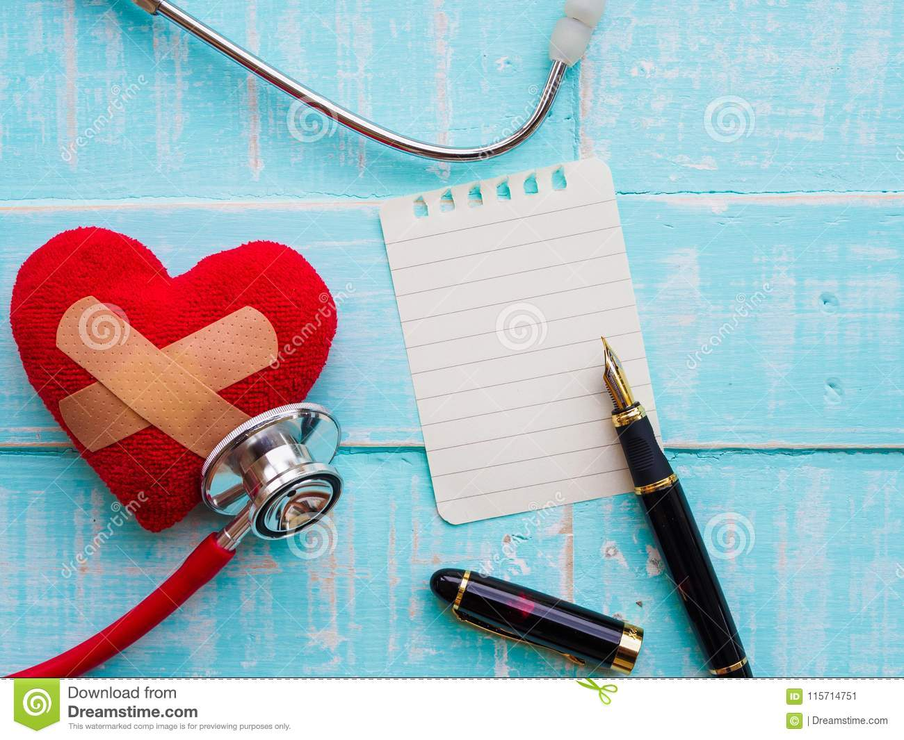 Red heart and stethoscope on blue bright wooden background. Heal