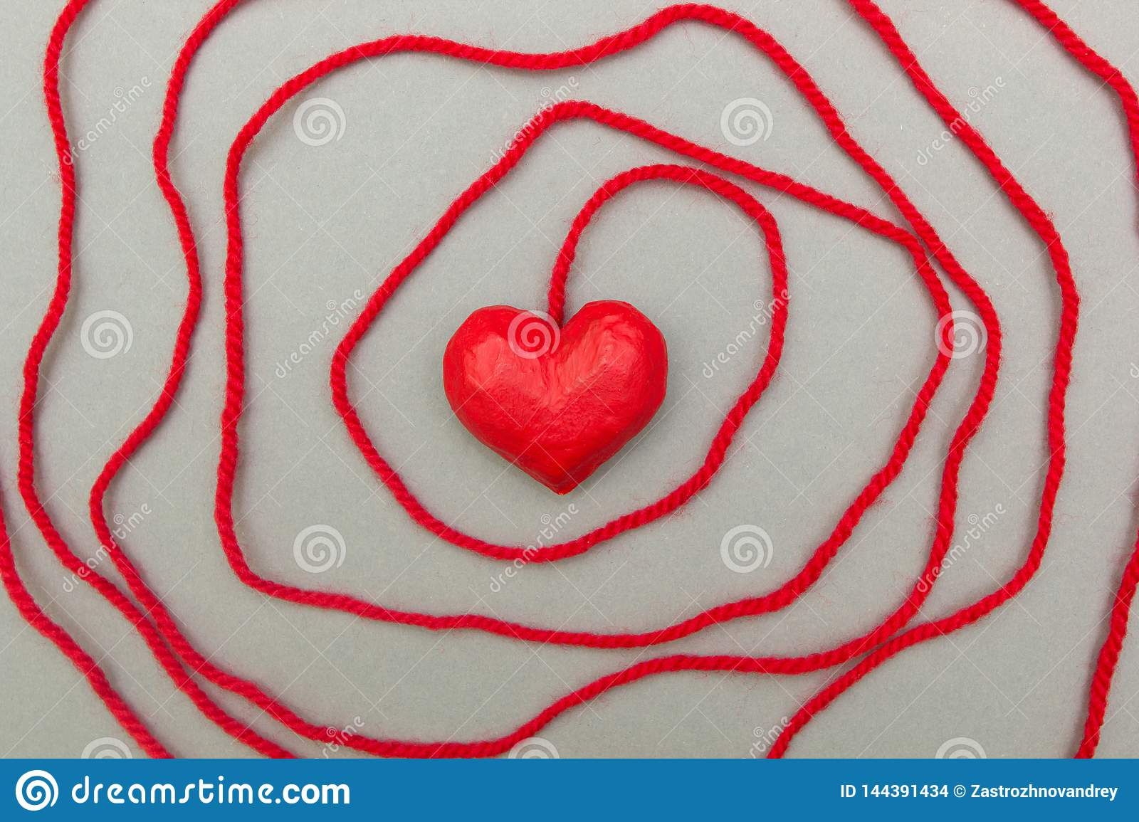 Red heart wrapped around with rope