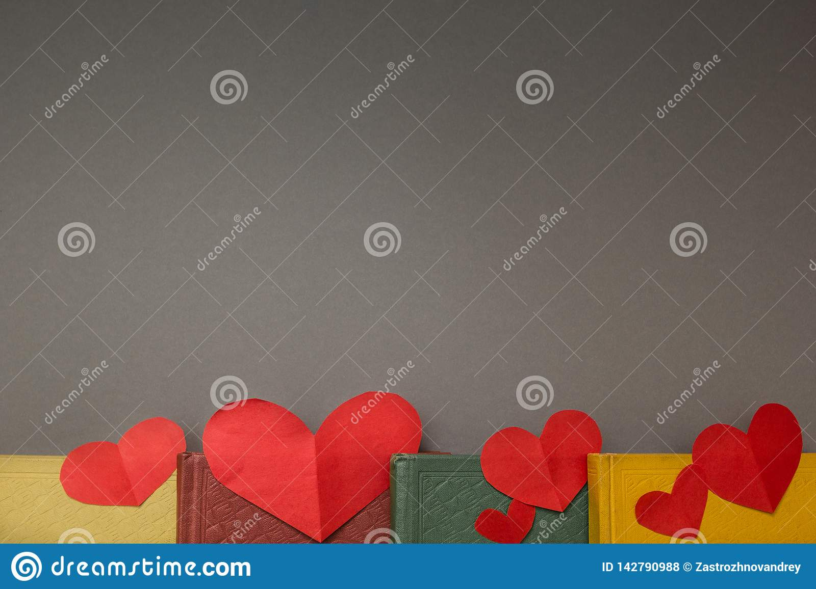 Red hearts on the books, space for text