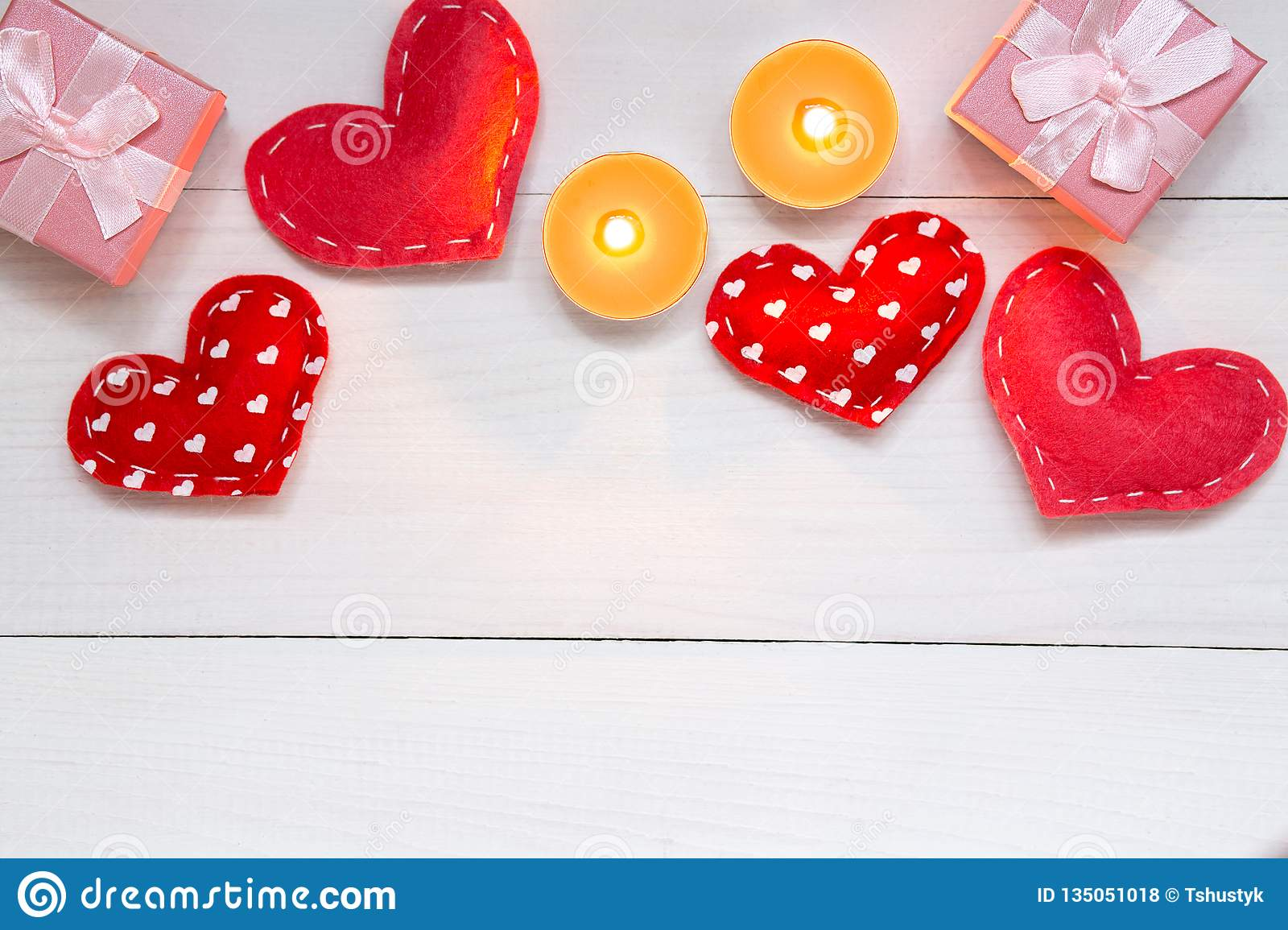 Red hearts and gift on white wooden background for Valentines day, copy space, top view