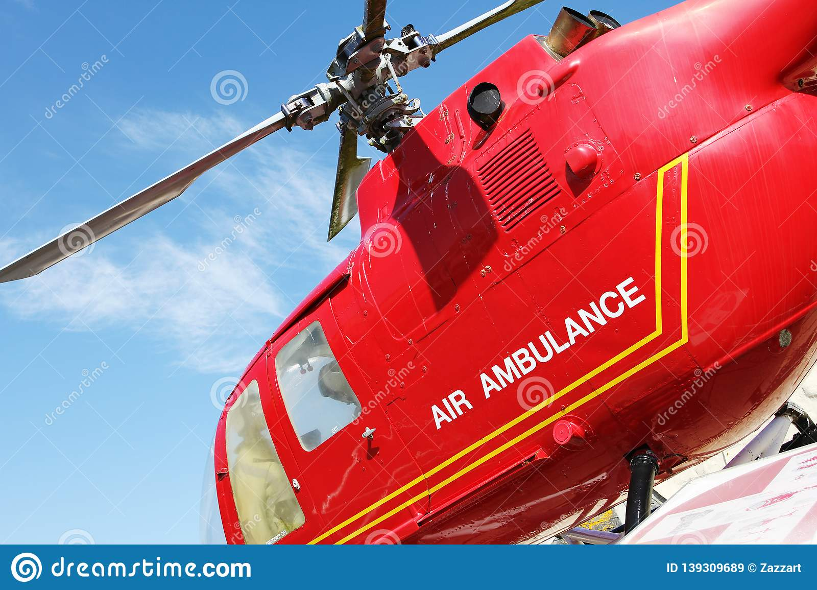 Red Helicopter Of Air Ambulance On Blue Sky Background  Detail Of