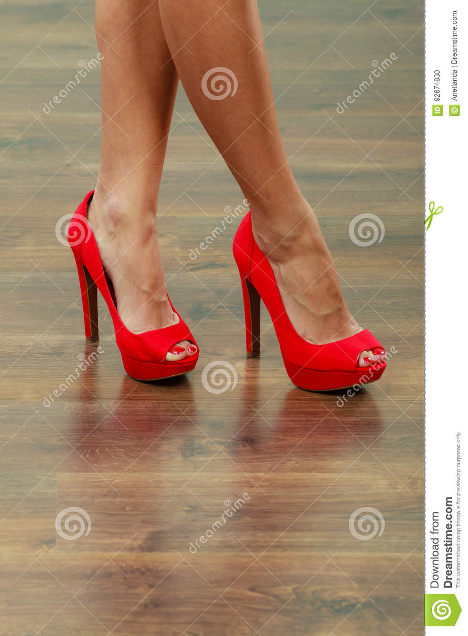 8583edff068 Red High Heels Spiked Shoes On Female Legs Stock Photo - Image of ...