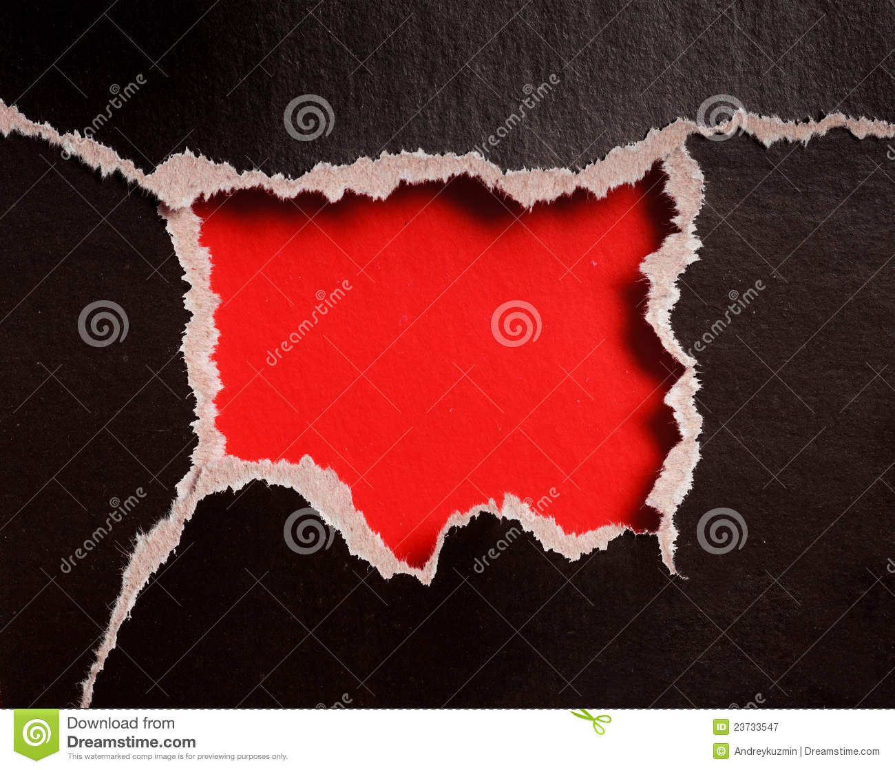 red hole with torn edges in black paper royalty free stock