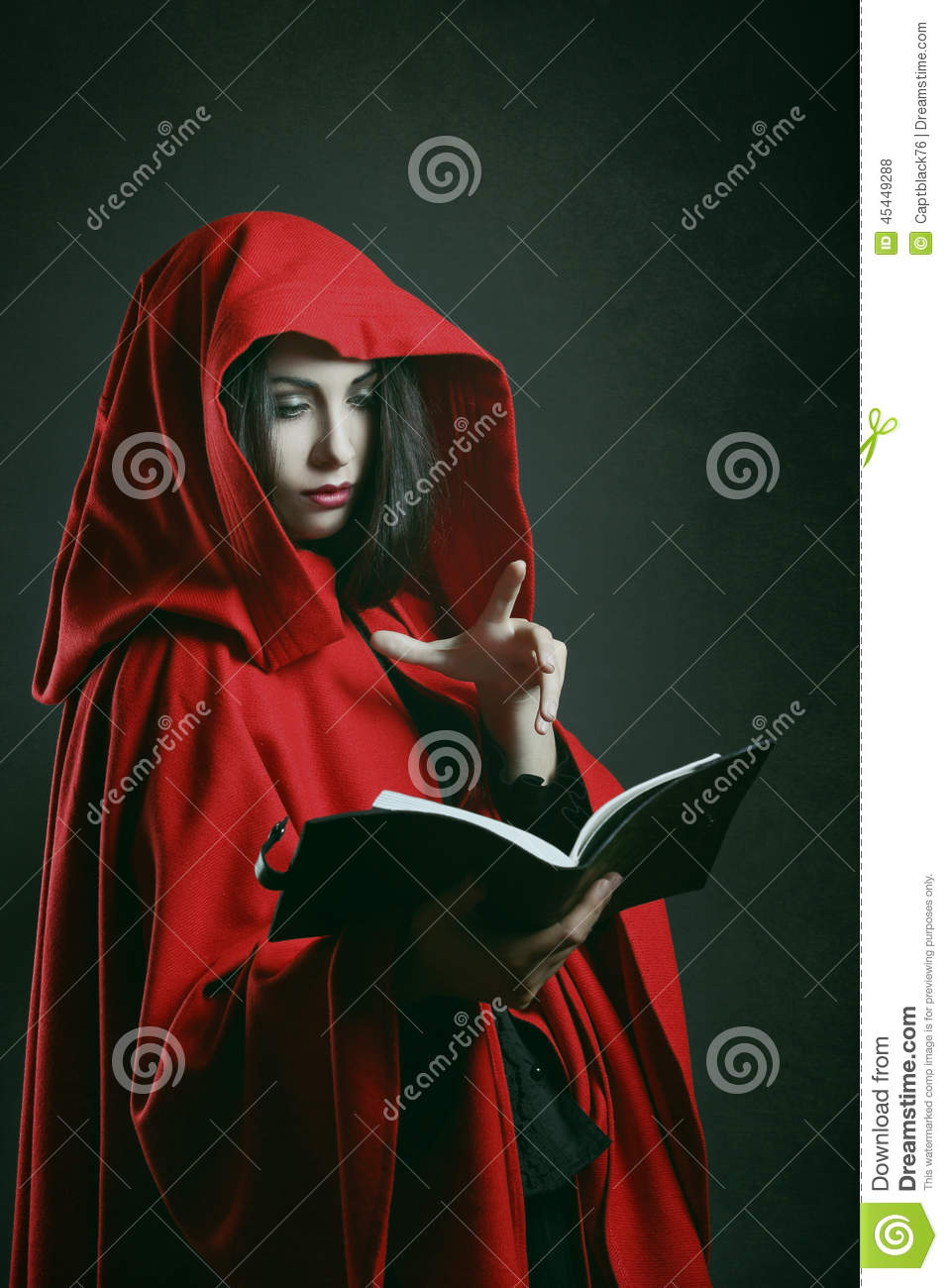 red hooded woman reading a book stock photo image 45449288