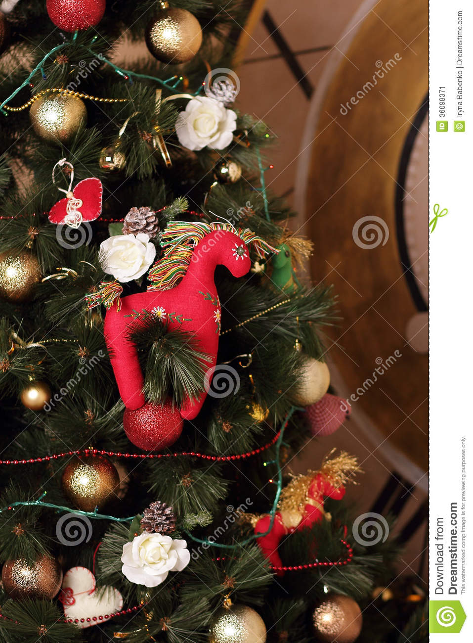 Christmas Decorations For Your Horse : Red horse on a new year tree stock image