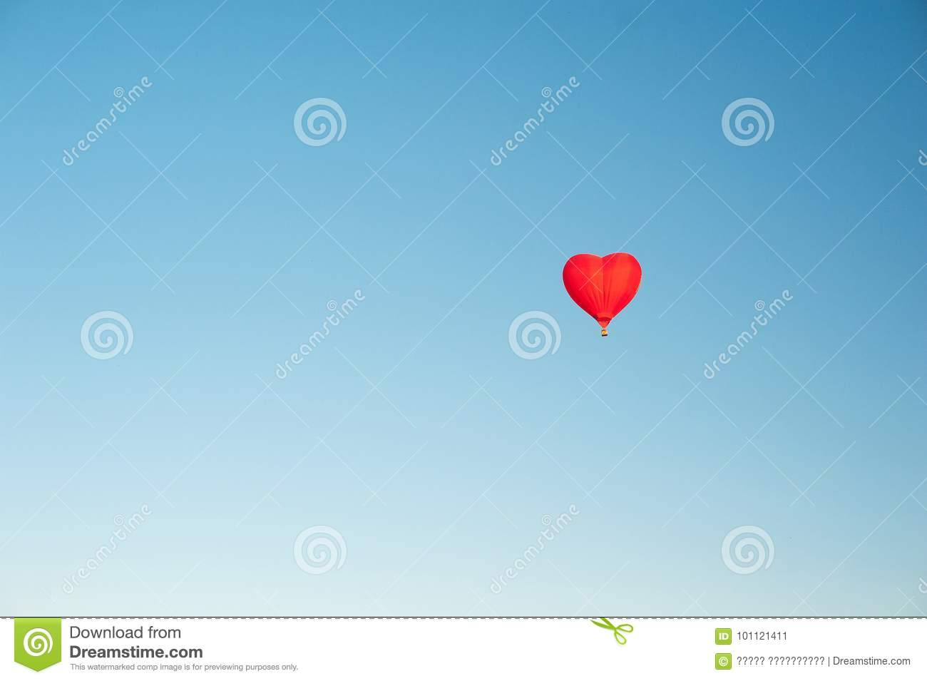 Red Hot Air Balloon In The Shape Of A Heart In Clear Blue Sky