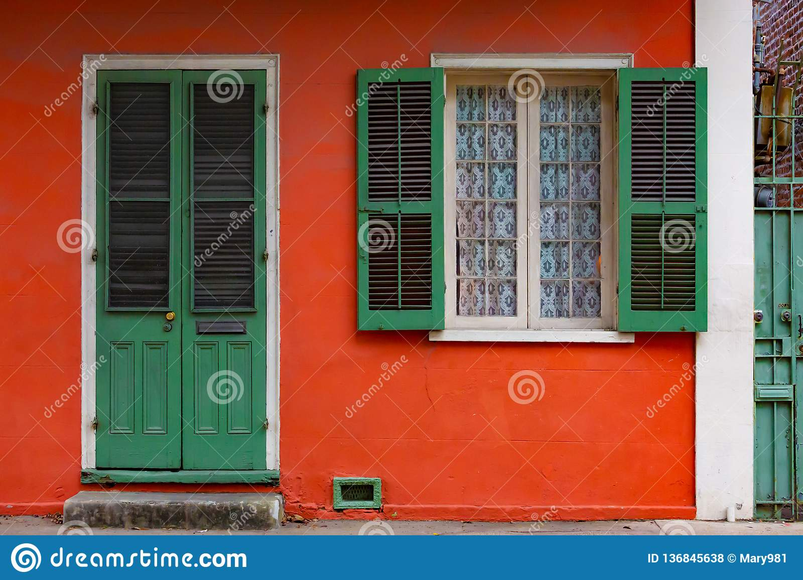 Red House With Green Shutters New Orleans Stock Photo