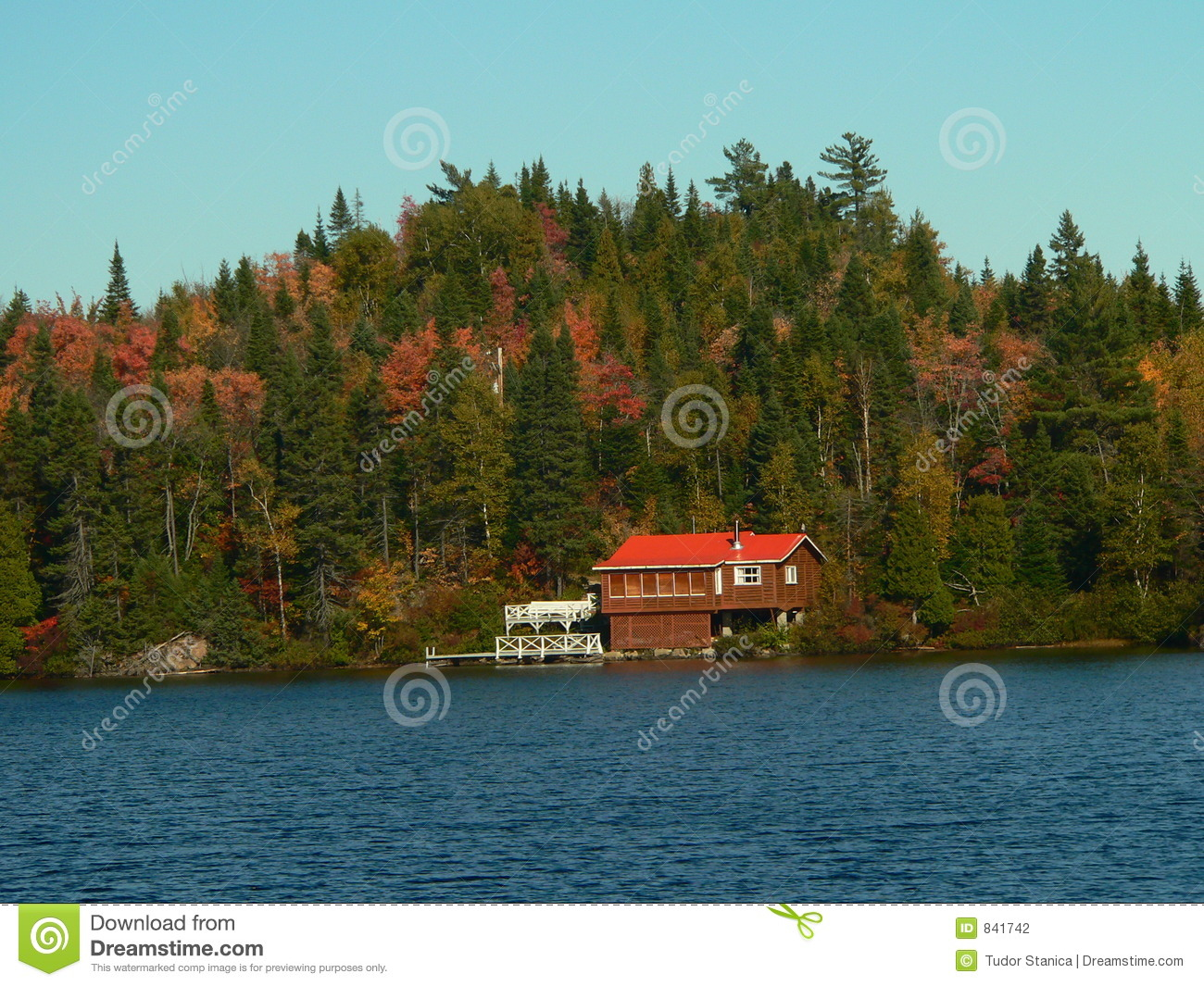 Red house on the lake shore