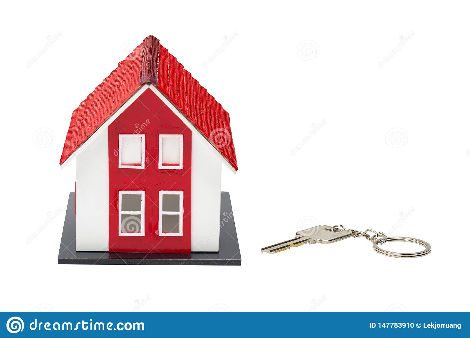 Red house model and house key isolated on white background