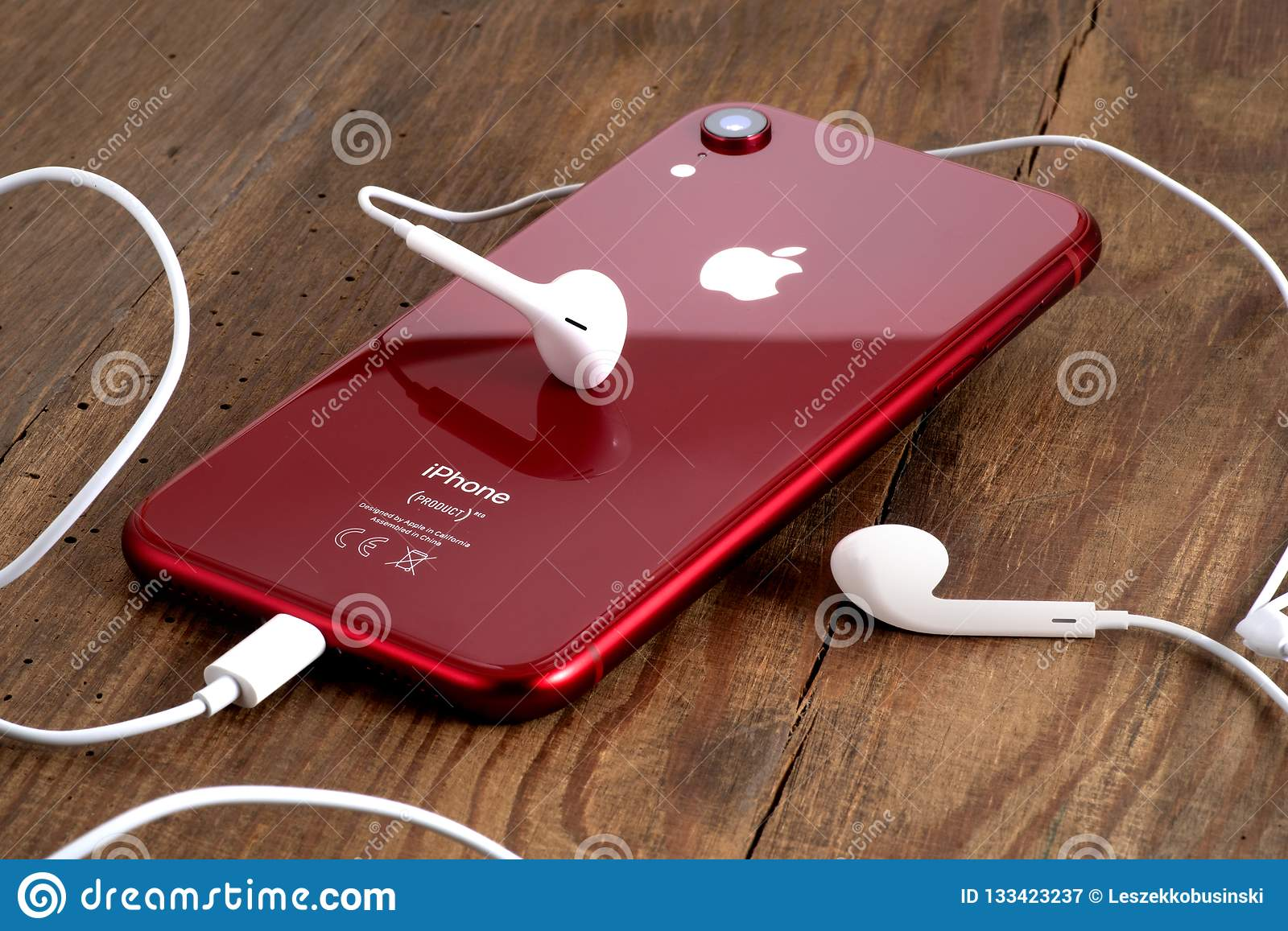 Red Iphone Xr On A Wooden Table With White Earphones Editorial Photography Image Of Design Gadget 133423237