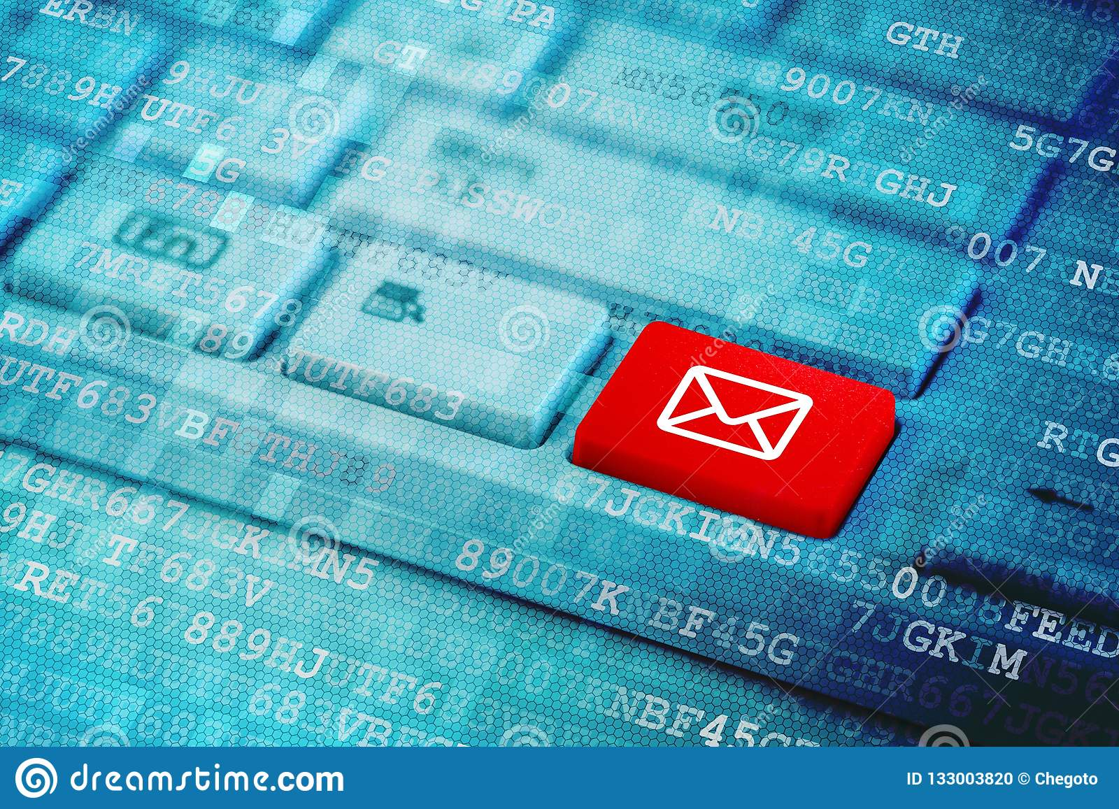 Red key with mail icon symbol on blue digital laptop keyboard