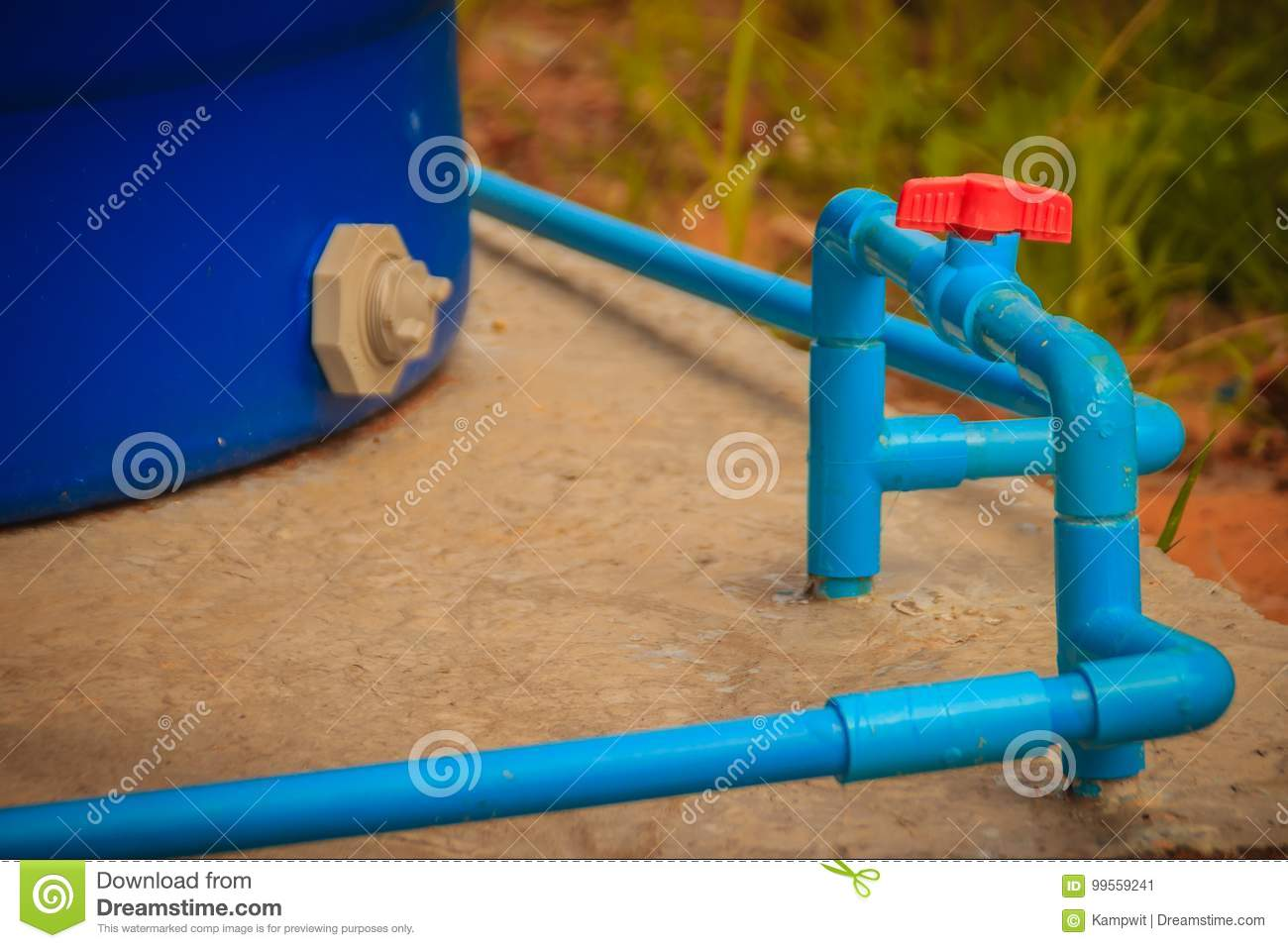 Red Knob Of PVC Ball Valve On The PVC Pipe Line In