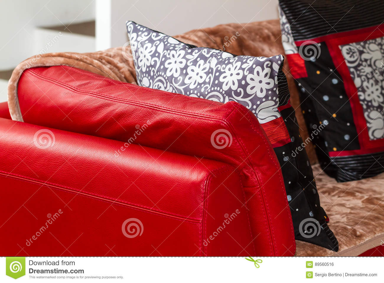 Red Leather Sofa With Throw Blanket And Cushions Stock Photo ...