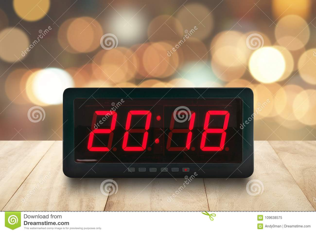 Red Led Light Illuminated Numbers 2018 On Digital Electric Alarm Clock Face  On Brown Wooden Table