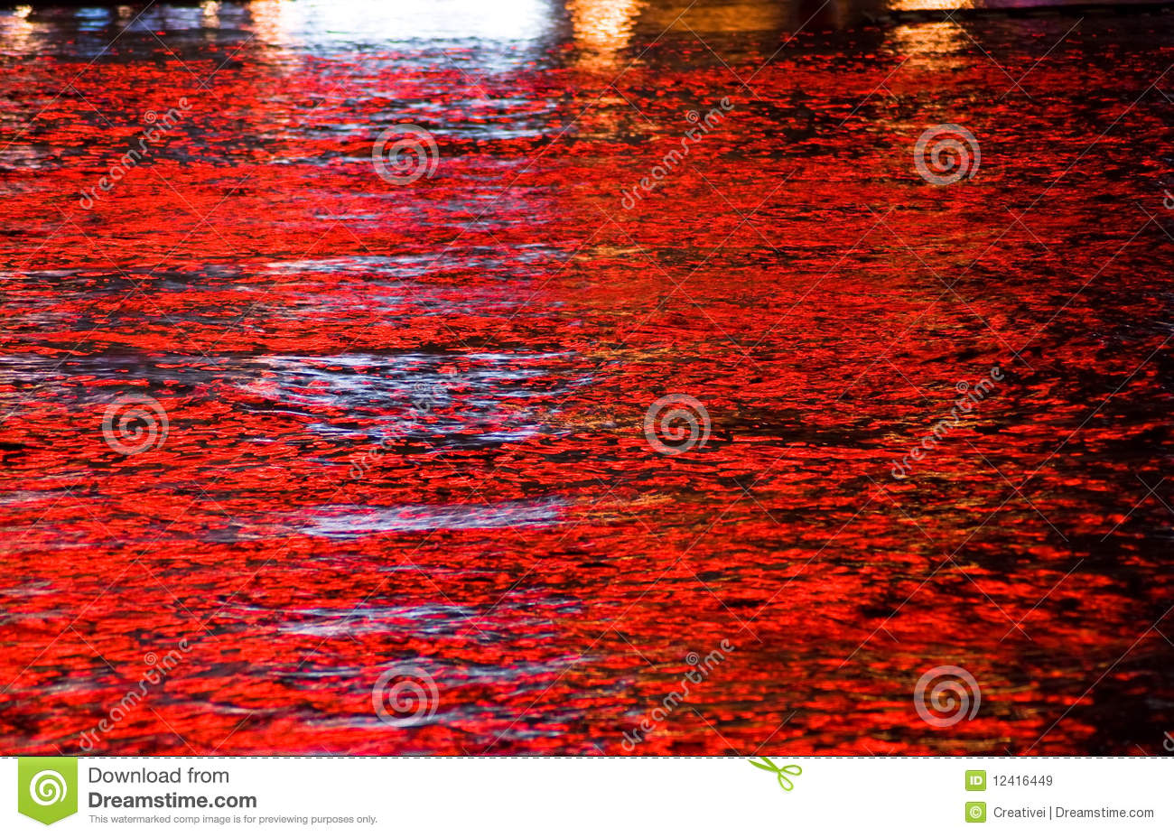Red lights reflected in water