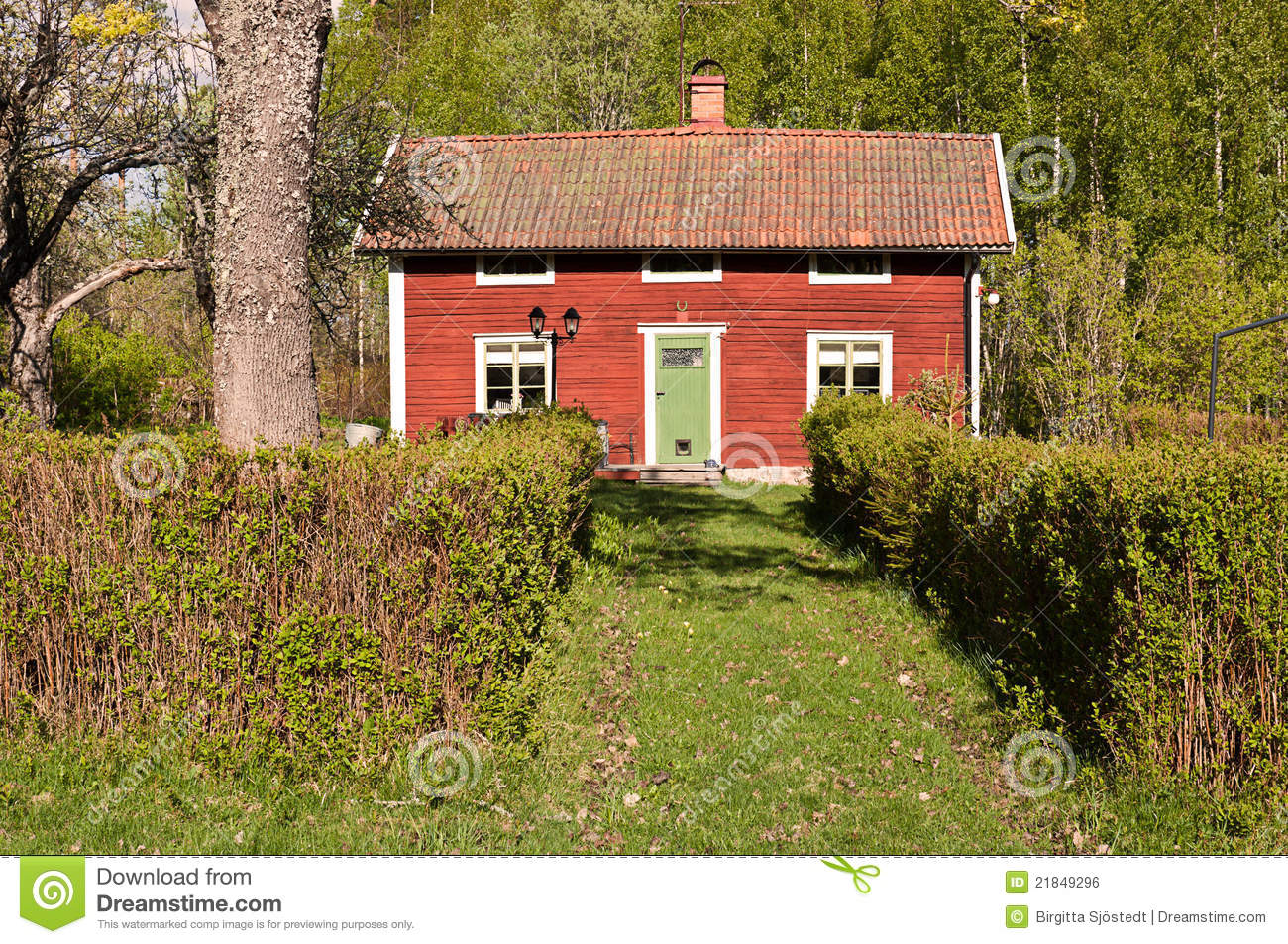 Red idyllic cottage in summer landscape royalty free stock for Red cottage