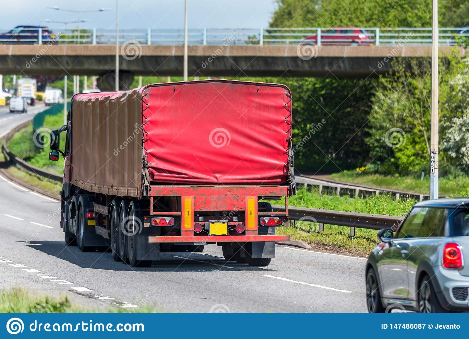 Red lorry truck on uk motorway in fast motion