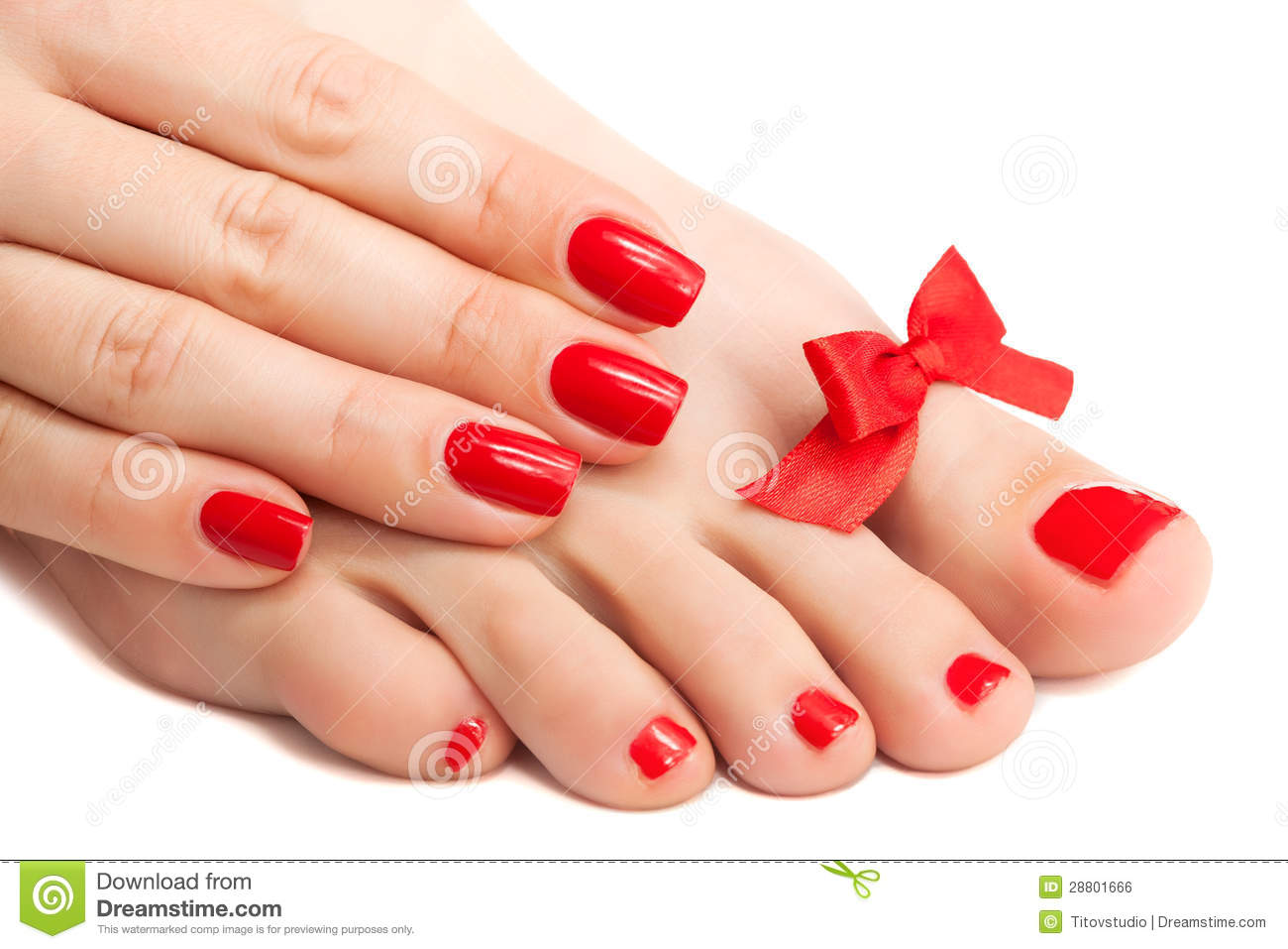 Red Manicure And Pedicure With A Bow Isolated Stock Photo