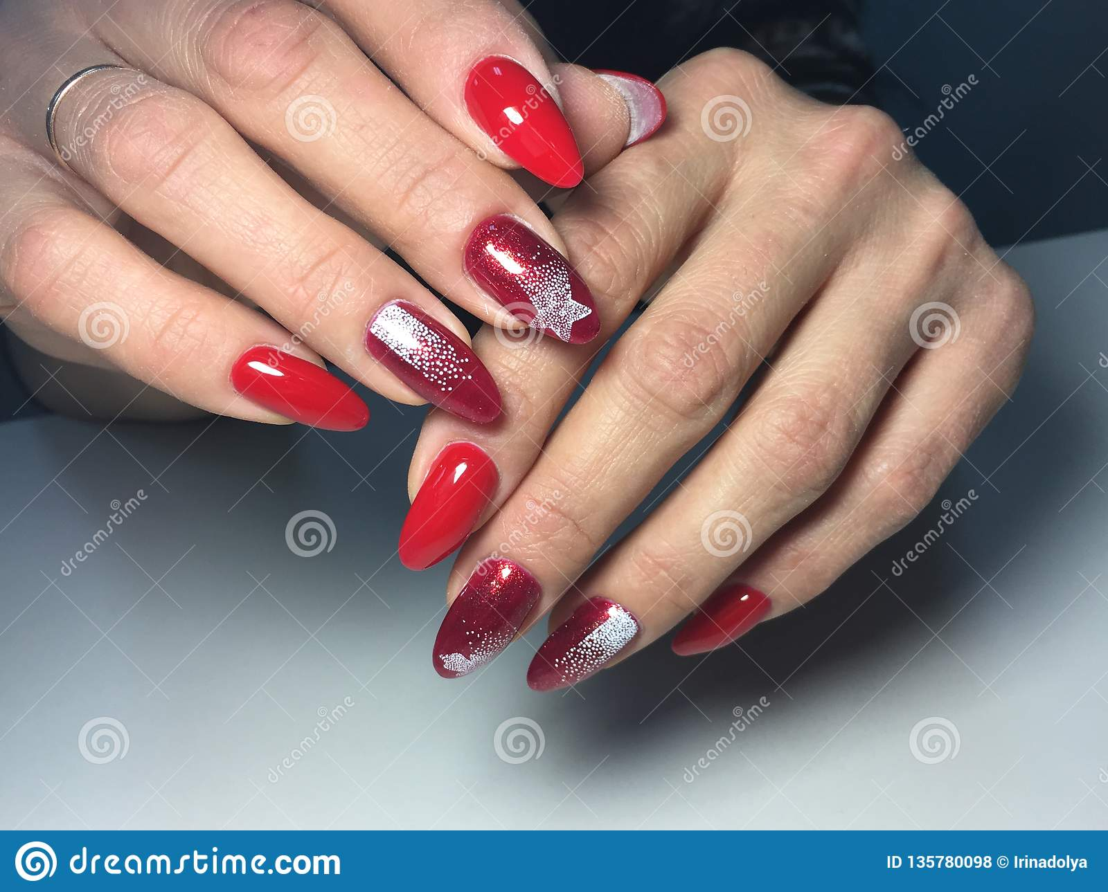 fashion red manicure with white snowflakes on long nails