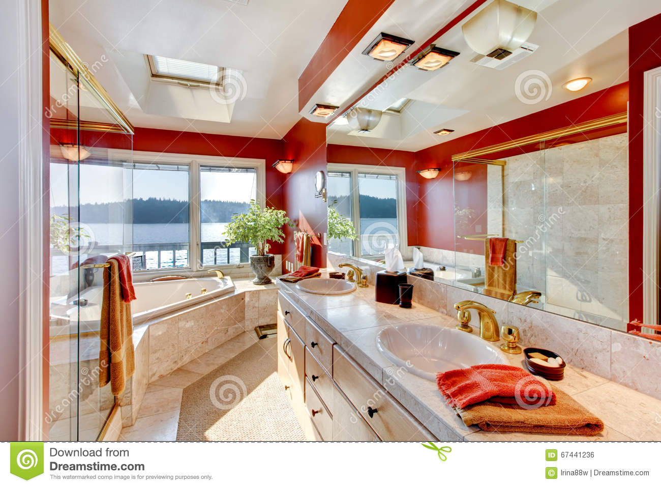 Red And Marble Interior Of Large Luxury Master Bathroom With Glass