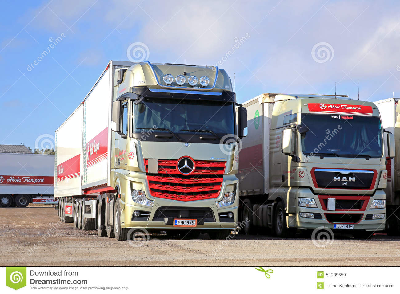 Red mercedes benz actros and man 2551 trucks on a yard for Mercedes benz man