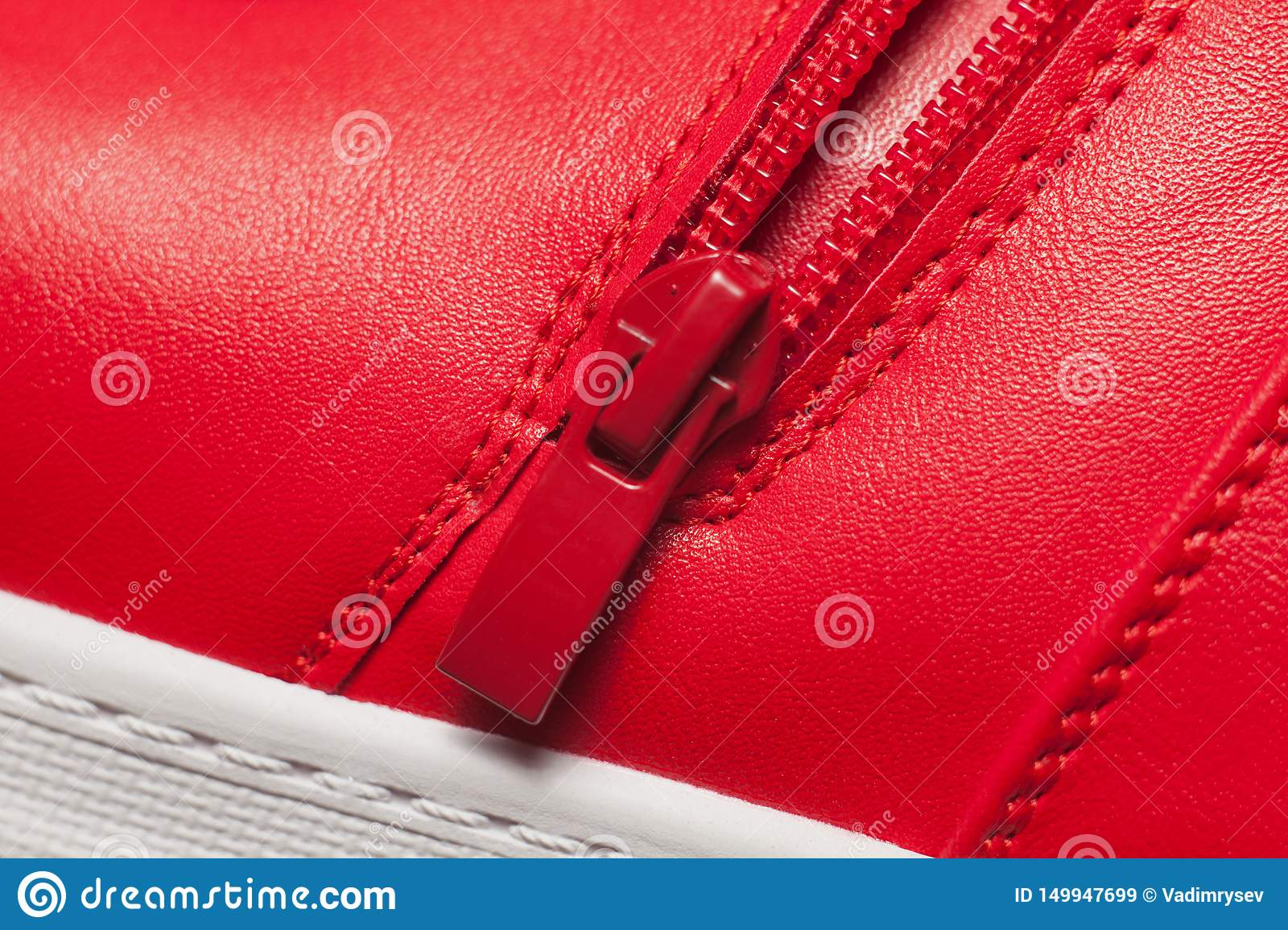 Red metal zipper on red sport boots